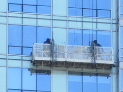 2018 Window Washers Cleaning Tower Halloween 4081 (Brechtbug) Tags: 2018 window washers cleaning glass apartment building tower halloween from hells kitchen clinton near times square broadway nyc 10312018 city midtown manhattan spring springtime weather dark low hanging cumulonimbus cumulus nimbus cloud hell s nemo southern view ny1 windows washer scaffold rig platform off buildings clean october