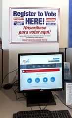 Computer station and a bilingual sign in English and Spanish to register to vote at the Milwaukee Public Library, Wisconsin (thstrand) Tags: 20102019 2018 21stcentury american bilingual booth cityofmilwaukee communications computer computerstation democracy election electioncommission elections electronicinformation english government informationtechnology inscribaseparavotar internet libraries milwaukee northamerica partnership partnerships politics publiclibrary redwhiteandbluecolors registertovote registering sign signup signingup signs spanish technicalhelp us usa unitedstates voter voters voting wi wisconsin