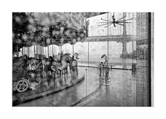 Merry-go-round (Paphylo) Tags: story leicaq marrygoround bridge people reallife newyork outdoor dumbo brooklyn monochrome cloud manhattan mood blackandwhite water atmosphere rain city document