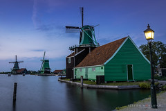Windmills at the Zaanse Schans (Koelman2008) Tags: netherlands holland zaandam mill windmill landscape blue hour zaanse schans zaan river water reflection sunset sky clouds golden gold light
