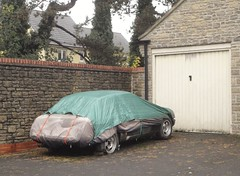 MGBGT (shagracer) Tags: tarpaulin under cover wraps wrap stood laid up covered sorn abandoned neglected forgotten stored project unfinished ongoing alloy wheels slots mags mg b gt sports car