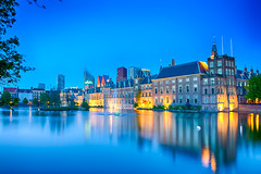 Travel Concepts. Binnenhof Palace of Parliament in The Hague in The Netherlands at Blue Hour. Against Modern Skyscrapers on Background. (DmitryMorgan) Tags: binnenhof gollandia gollandiya haag hague holland netherlands architecture bluehour buildings denhaag dusk dutch europe evening fountain government governmental historic hofvijver hollander kingdomofthenetherlands lights mauritshuis newplaces night places pond reflections skies skyline skyscrapers specific towers travellingconcept unique water