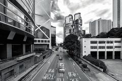 Monochromatic Hong Kong (Lemuel Montejo) Tags: citystreet street rushhour pedestrian zebra crossing road crosswalk busstop traffic tram trafficjam light buildings hongkong china travel tour nikon tamron benro lemuelmontejoartworks mvisuals