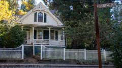 White picket fence (Vurnman) Tags: california norcal nevadacounty nevadacity fallphotowalk smalltown autumn house fence porch shade