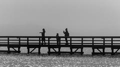 on that faithful day / loosing sense of time and space (Özgür Gürgey) Tags: 169 2018 70300mm bw büyükçekmece d750 nikon bridge fog lake lines people silhouettes wood istanbul woman child