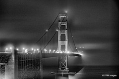 Foggy Night (pandt) Tags: foggy night goldengate bridge monochrome blackandwhite bw image pic flickr outdoor nightshot lights cars sky water ocean bay sanfrancisco california waterscape landscape grey black white cable vacation travel canon rebel t1i slr