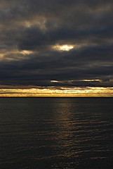 Cosmic clouds (Pwern2) Tags: sunrise darkclouds horizon water landscape nature sky lakeontario greatlakes ontario scarborough scarboroughbluffs toronto to the6 sunlight sunbeams sunrays sunshine waves breeze pier marina beach clouds