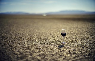 A wine glass, a playa, and a moon