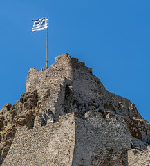 Flag ( Myrina Castle) (Myrina Town - Limnos - Greece) (Olympus OM-D EM1-II & M.Zuiko 40-150mm f2.8 with MC14 Teleconverter) (1 of 1) (markdbaynham) Tags: greece greek hellas hellenic grecia greka gr greekisland greekholiday greektown northaegean northaegeanisland aegeanisland travel olympus omd olympusomd olympusgreece olympusmft olympusem1 m43 m43rd micro43 em1 em1mk2 em1mark2 em1ii csc evil mirrorless microfourthird microfourthirds greektravel hellenicisland limnos lemnos myrina mypina myrinatown castle myrinacastle mc14 40150mm mzd mz zd mzuiko zuikolic