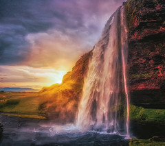 Sunset at Seljalandsfoss, Iceland (S.A.W. Pixels) Tags: artistic amazing arts black white canon art iceland atlantic dramatic dark darkclouds drama excellent exposure exciting explore explored exposed flickr greatphotographers interesting impressive landscape landscapes outdoor observing outside overcast picture panaromic photo syedaliwarda sea sky mountain ocean water seljalandsfoss waterfalls rock waterfall sunset grass