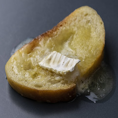 brie on bread... ooops, bit too melted (MyArtistSoul) Tags: brie baguette sourdough bread piece 9456