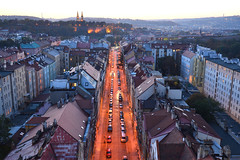 Another evening view over Praha 2 district: 15 minutes after sunset (Pavel's Snapshots) Tags: nikon d750 evening dusk late roofs houses street road lights illumination orange blue sky old historic historical bridge panorama view distant valley vysehrad residential area district prague praha czech czechrepublic urban town city landscape cityscape dramatic 35mm haze twilight europe mist density traditional tileroof vivid