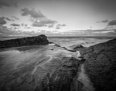Luquillo (Eddie La Mole) Tags: sandyhills luquillo atlanticocean sea rocks coast bw crowngraphic fujinonswd75 shanghaigp3 f22 d76 95mins88°f