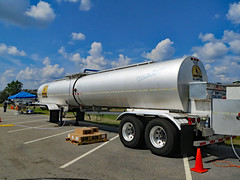 Tanker Trailer. (dccradio) Tags: lumberton nc northcarolina robesoncounty outdoor outdoors outside sky bluesky cloud clouds cloudformation september sunday afternoon fall autumn hydepark hydeparkbaptistchurch hurricaneflorence reliefstation disasterrelief naturaldisaster hurricane florence trailer ncbaptists baptistmen baptistsonmission tanker box boxes pylon cone whitelines parkinglot parking parked paved pavement prayerstation ezup canon powershot elph 520hs