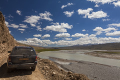 Travelling in Kyrgyzstan (Joost10000) Tags: kyrgyzstan asia central centralasia travel adventure road car river valley mountains outdoors wild wilderness sky clouds canon canon5d eos mountainrange tienshan tien shan