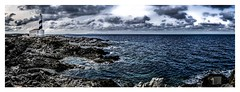 .......I.______________________ (Luis kBAU) Tags: faro sea rocks rocas nubes clouds soledad lonelyness favarix lighthouse ocean sky