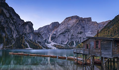 Sunrise, Lago di Braies, Dolomites, Italy (MelvinNicholsonPhotography) Tags: lagodibraies dolomites italy water lake sunrise woodenrowingboats woodenboats boathouse mountains seekofelmountain