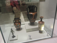 Greek vases and little figure,   CaixaForum, Madrid, June 2018 (d.kevan) Tags: exhibitions caixaforum ancientinstruments displaycabinets june2018 madrid spain exhibits greek ceramic vases fidures