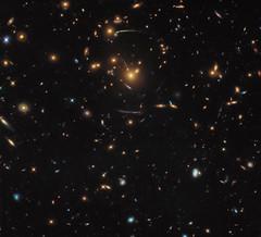 Hubble's Warped View of the Universe (NASA's Marshall Space Flight Center) Tags: nasa goddard space flight center gsfc hubble telescope solar system beyond esa european agency universe astronomy galaxy galaxies galactic cluster sdssj10500017