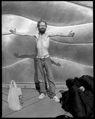 P. Standing with Arms Outstretched 180928 (jimhairphoto) Tags: streetlife streetstories théâtrederue portland oregon america pdx portlandnw remainsoftheday naturalworld 4x5project crown graphic camera mfg1963 4x5 ilford hp5 film blackandwhite blancetnoir schwarzweiss blancoynegro blancinegre siyahrebeyaz jimhairphoto
