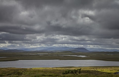 Rainy day in Lewis (Joost10000) Tags: grass moor bog landscape landschaft mountain mountains sky lake pond water rain cloud clouds lewis isle isleoflewis hebredies outerhebredies scotland ecosse schotland uk great britain europe europa canon canon5d eos outdoors travel