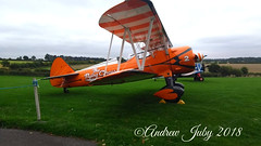 Aerosuperbatics Boeing Stearman #2 (First Choice 360 Mediaworks) Tags: orange boeing stearman brietling wing walkers aerosuperbatics flying circus stunt plane formation wingwalking team raf rendcomb cirencester airfield