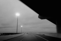 Toll road {294/365} (therealjoeo) Tags: 365 365project texas blackandwhite road highway toll lights bridge overpass car