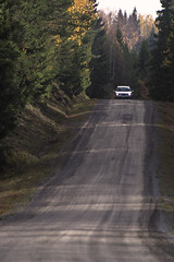 Dusty road (hasor) Tags: road country forest car driving trees autumn fall värmland spruce zoom
