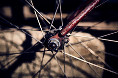 Sunset star (iamunclefester) Tags: münchen munich hub wheel bicycle bike spoke spokes bicyclespokes red varnish paint old used metallic mark scratched sunset star nut fork asatouristinmyhometown manualfocusday manualfocus
