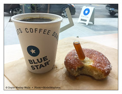 That's a Mousse Made with Coava Coffee Inside the Donut and a Pipette of Hue-Hue Coffee Rum Stuck into the Top of the Donut, Paired with a Hot Cup of Coava Coffee (Doyle Wesley Walls) Tags: lagniappe 8715 bluestardonuts pipette coavacoffee coavacoffeemousse treat dessert snack coffee sweets iphonephoto doylewesleywalls babaauhuehuecoffeerum eastsidedistilling portlandoregon doughnut donut confection sugar papercup java