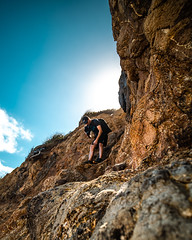Joel Staveley - Mercer bay cliff - West Coast (Moa-photography-nz) Tags: photographer photography cliff orange blue sun beach coast climb rock rocks view beauty nature travel adventure nz auckland west shore waves sky light cinematic mood moody natural