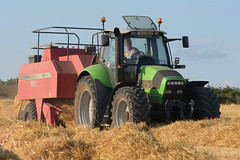 Deutz Fahr Agrotron M650 Profiline Tractor with a Massey Ferguson 185 High Density Baler (Shane Casey CK25) Tags: deutz fahr agrotron m650 profiline tractor massey ferguson 185 high density baler deutzfahr sdf df grain harvest grain2018 grain18 harvest2018 harvest18 corn2018 corn crop tillage crops cereal cereals golden straw dust chaff county cork ireland irish farm farmer farming agri agriculture contractor field ground soil earth work working horse power horsepower hp pull pulling cut cutting knife blade blades machine machinery collect collecting nikon d7200 traktor traktori tracteur trekker trator ciągnik castlelyons