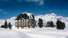 The Villa Cassel at the Riederfurka (VandenBerge Photography (and we're back again)) Tags: riederfurka winter winterscape villacassel cantonofvalais aletscharena alps canon panorama sky mountains switzerland season snow snowscape historical landscape pronatura riederalp