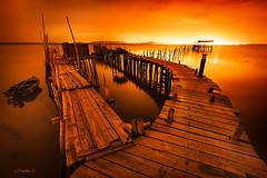 Palafitte Fantasy. (darklogan1) Tags: pier palafitte water night nightphotography longexposure zeissze1528 sonyilce7rm2 sony zeiss orange yellow carrasqueira setubal portugal logan darklogan1 serene wooden