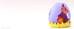 Birth of a dinosaur... (Maria Godfrida) Tags: 2dwf challengeonflickr newbeginning objectbookmark cof040 birth egg dinosaur object minimalism colours whitebackground fauna animal cof040fdls cof040dmnq cof040cott cof040anke cof040mark