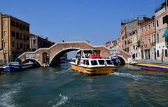 Venice canals (One more shot Rog) Tags: venice italy northernitaly venetian gondola gondolier boat boats rialtobridge stmarkssquare onemoreshotrog bridge grandecanal rialto canal canals river