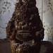 Demon deity on entranceway table