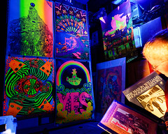 It's the '60s in the basement.  Again. (black light) (Thiophene_Guy) Tags: thiopheneguy originalworks olympusomdem5ii utatasweekendproject utata:project=icon blacklight posters psychedelic countercultureofthe1960s hippieart