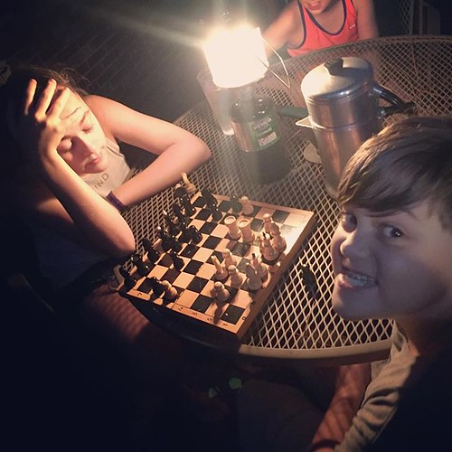 A little fun by #lantern as dad cooks dinner on the #backdeck #grill #hurricanemichael #poweroutage #campingfamily #chess #gamenight #familygamenight #guesswhoswinning