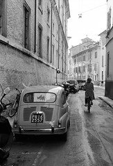 Old scene (sam.naylor) Tags: italy black white monochrome europe travel film 120 ilford road hp5 city street mood parma contax g1 zeiss 45mm 35mm motor fiat 600 car classic