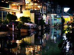 Once there was a street (dlerps) Tags: bkk bangkok city daniellerps lerps sigma sony sonyalpha sonyalpha99ii tha thai thailand urban lerpsphotography metropolitan street night reflection car carlzeiss carlzeissplanar50mmf14ssm planart1450 water puddle flood flooding evening rain streetphotography sukhumvit overflow wetseason lights sukhumvitsoi57 asia