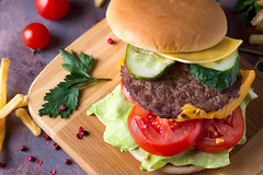 Tasty grilled home made burger cooking with beef, tomato, cheese, cucumber and lettuce. Top view, close up (lyule4ik) Tags: burger hamburger rustic beef meat snack bun bbq wooden food lunch meal gourmet grilled homemade delicious fast lettuce american sandwich sauce restaurant background cheeseburger table wood cheese tasty barbecue onion unhealthy street takeaway patty bread dinner tomato paper style streetfood menu country refreshment space grill fastfood cuisine salad brown fresh