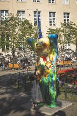 Migrant and the bear. Rathaus Neukölln, September 2018. (joelschalit) Tags: berlin neukölln germany deutschland refugees migrants asylumseekers streetphotography europe europeanunion eu ethnicity tolerance multiculturalism diversity fujifilmx100f africans africa kids
