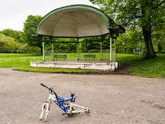 Bandstand - Parr Fold Park, Walkden (Peter.Bartlett) Tags: urbanarte lunaphoto bandstand urban unitedkingdom olympusomdem5 nikcolorefex m43 microfourthirds uk city park bike peelingpaint peterbartlett fence
