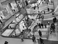 Eaton Centre, Toronto, Ontario (duaneschermerhorn) Tags: black white blackandwhite blackwhite bw noire noir blanc blanco schwartz weiss people shopping mall levels tiers men women shops glass railings overlook