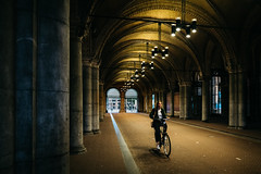Early Morning Ride (Trent's Pics) Tags: street photography amsterdam architecture bicycle bicyclists city cityscape female holland lifestyle lights museum netherlands people portrait rijksmuseum streets tunnel