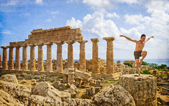 Take them off! (Tiigra) Tags: italy it castelvetrano provinceoftrapani 2018 antiquity architdetail architecture column funny museum person plant repetition rock ruin sea selinunte sicily sky pattern