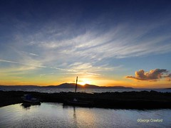 Portencross October Sunset2 (g crawford) Tags: portencross westkilbride ayrshire northayrshire clyde riverclyde firth water sea harbour harbor sky skies sunset sundown gloaming orange blue boat arran cloud clouds seaside