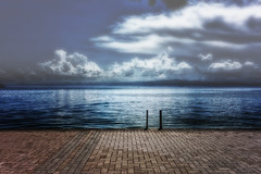 One Foggy Night (Alfred Grupstra) Tags: nature water lake sky cloudsky sea outdoors nopeople blue landscape reflection scenics tranquilscene cloudscape pier summer beach beautyinnature jetty dusk macedonia fog mist