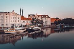 Good evening Lübeck (mattinho2704) Tags: oldcity deutschland bluehour hanse church citycenter reflection baluestunde city cityscape boats reise lights longexposurephotography sonyalpha baltic ostsee balticsea longexposure moon lübeckerbucht sony architecture germany calm travel hansestadt reflections